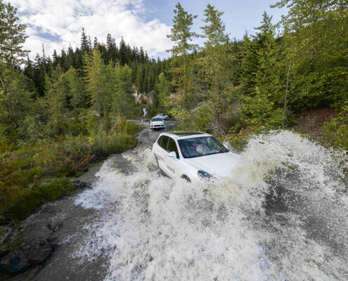 Porsche Cayenne crossing a river in Whistler