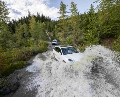 Porsche Cayenne crossing a river in Whistler