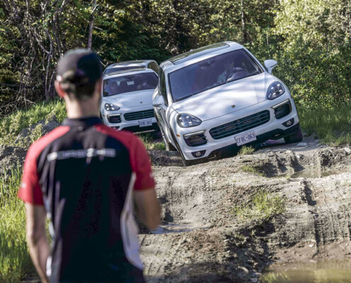 Porsche Cayennes on an offroad course in whistler